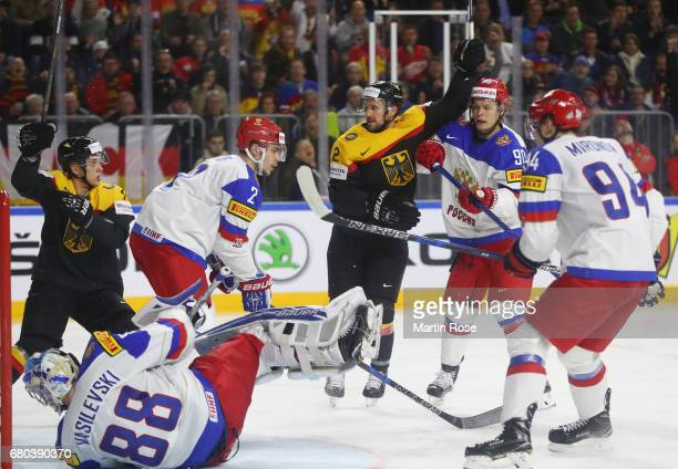 Brooks Macek of Germany celebrates scoring his goal during the 2017 IIHF Ice Hockey World Championship game between Germany and Russia at Lanxess...