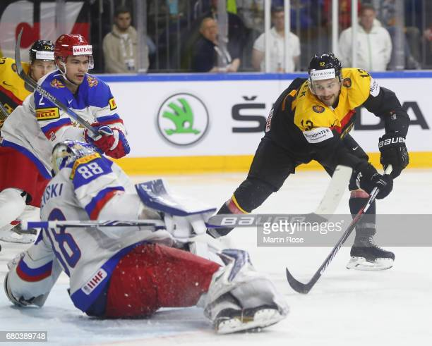Brooks Macek of Germany scores his goal during the 2017 IIHF Ice Hockey World Championship game between Germany and Russia at Lanxess Arena on May 8...