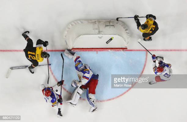 Brooks Macek of Germanyhas a shot saved by Andrei Vasilevski of Russia during the 2017 IIHF Ice Hockey World Championship game between Germany and...