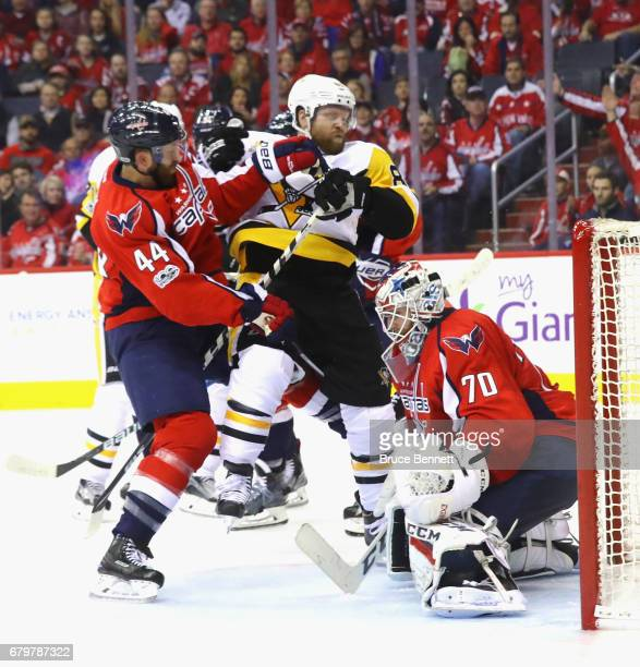 Brooks Orpik and Braden Holtby of the Washington Capitals defend against Phil Kessel of the Pittsburgh Penguins during the second period in Game Five...