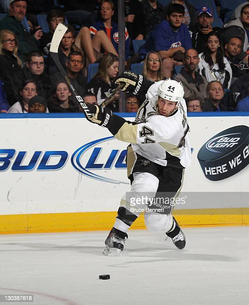 Brooks Orpik of the Pittsburgh Penguins breaks his stick while taking a shot against the New York Islanders at Nassau Veterans Memorial Coliseum on...
