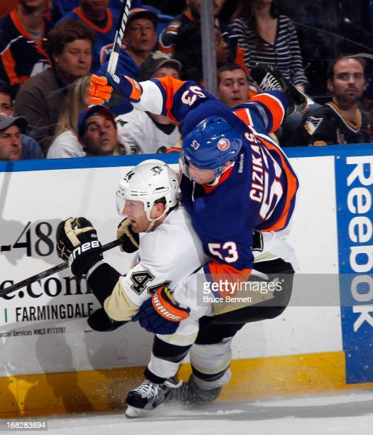 Brooks Orpik of the Pittsburgh Penguins checks Casey Cizikas of the New York Islanders during the second period in Game Four of the Eastern...