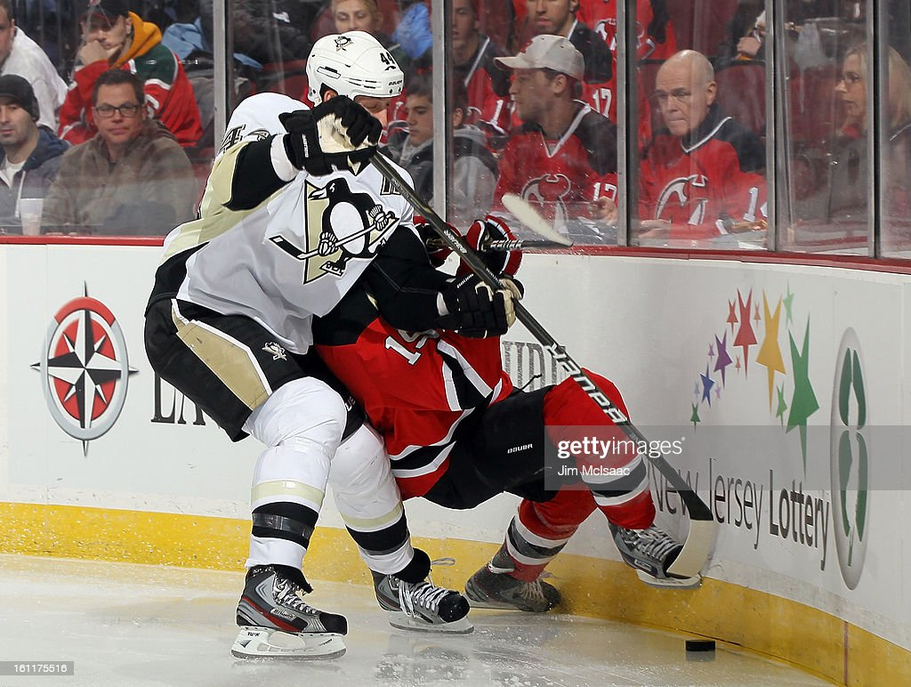 Brooks Orpik #44 of the Pittsburgh Penguins checks Travis Zajac #19 of the New Jersey Devils at the Prudential Center on February 9, 2013 in Newark, New Jersey.