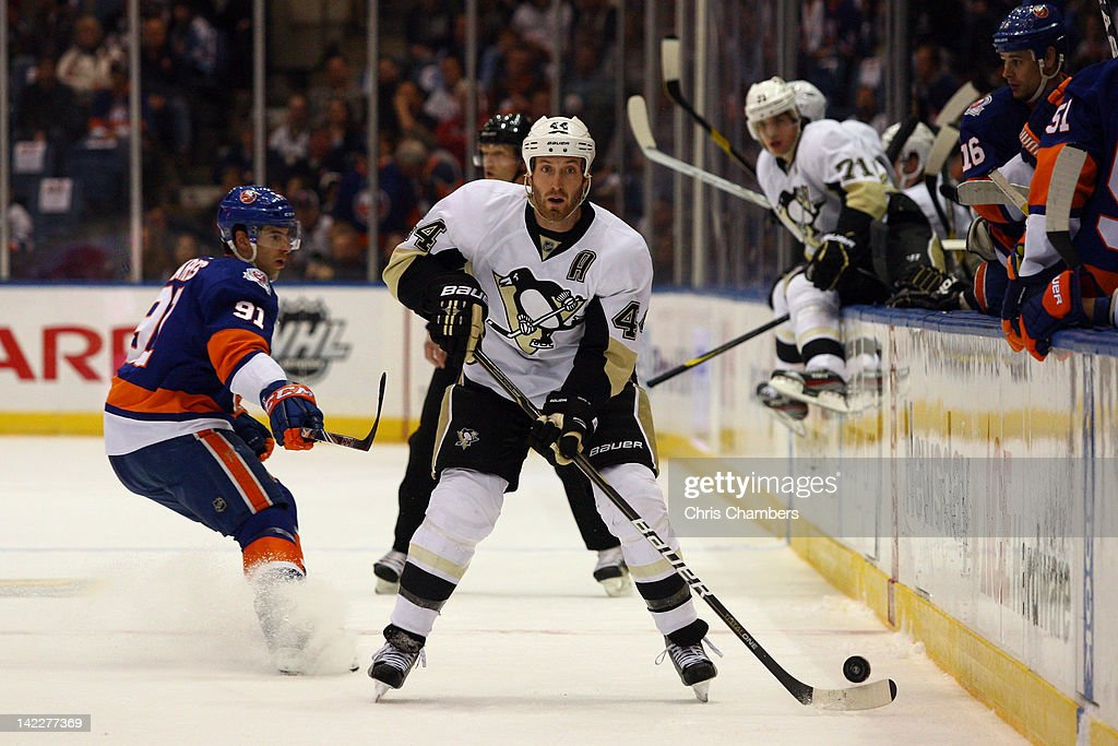 Brooks Orpik #44 of the Pittsburgh Penguins controls the puck against the New York Islanders at Nassau Veterans Memorial Coliseum on March 29, 2012 in Uniondale, New York.