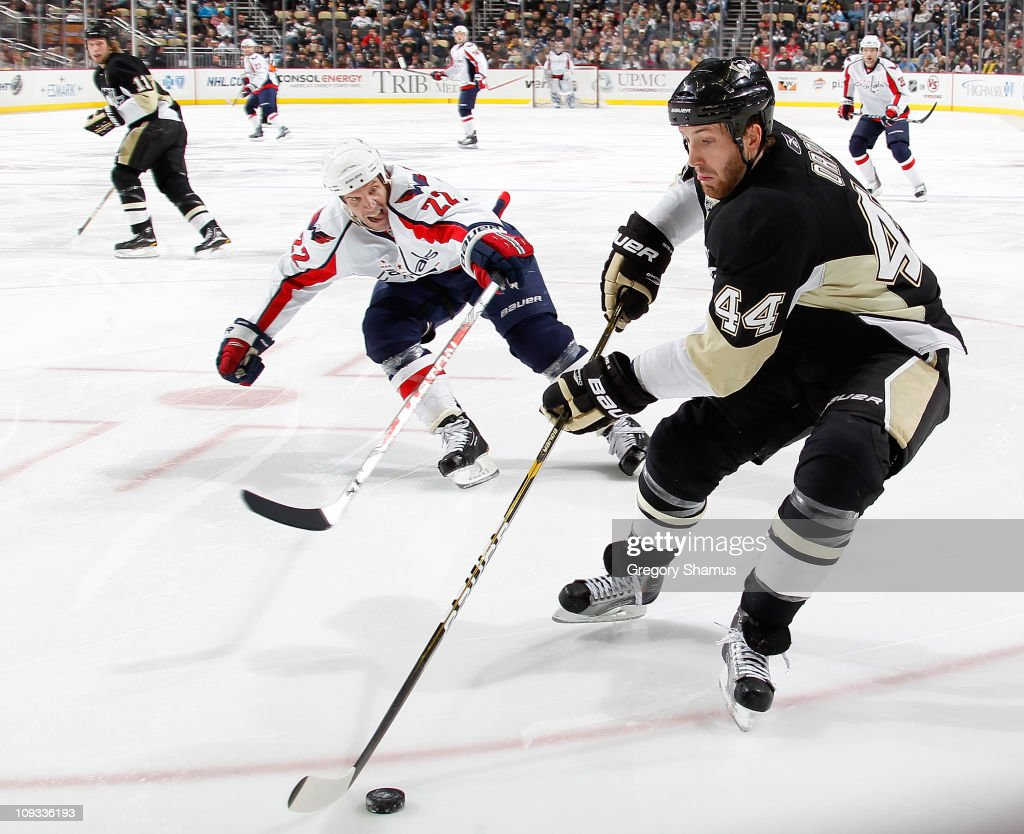 Brooks Orpik #44 of the Pittsburgh Penguins controls the puck in front of Mike Knuble #22 of the Washington Capitals on February 21, 2011 at Consol Energy Center in Pittsburgh, Pennsylvania.