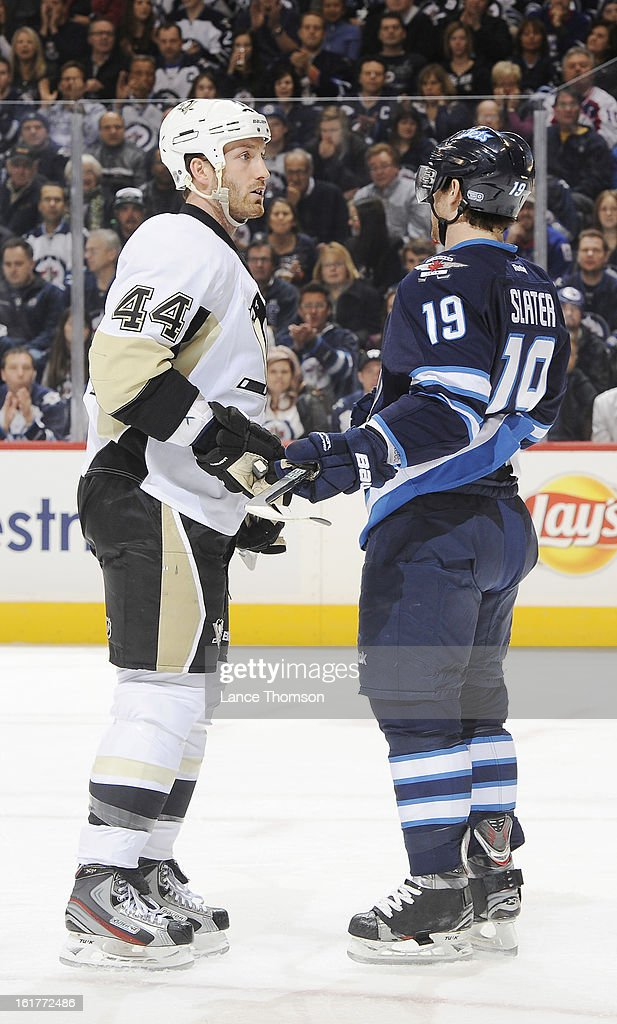 Brooks Orpik #44 of the Pittsburgh Penguins exchanges words with Jim Slater #19 of the Winnipeg Jets during a first period stoppage in play at the MTS Centre on February 15, 2013 in Winnipeg, Manitoba, Canada.