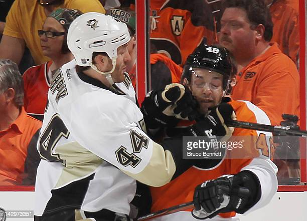 Brooks Orpik of the Pittsburgh Penguins highsticks Danny Briere of the Philadelphia Flyers in Game Three of the Eastern Conference Quarterfinals...
