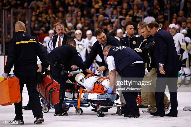 Brooks Orpik of the Pittsburgh Penguins is carted off of the ice on a stretcher by the medical staff in the first period after an altercation with...