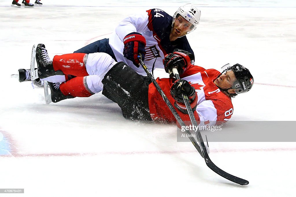 <a gi-track='captionPersonalityLinkClicked' href=/galleries/search?phrase=Brooks+Orpik&family=editorial&specificpeople=213074 ng-click='$event.stopPropagation()'>Brooks Orpik</a> #44 of the United States and <a gi-track='captionPersonalityLinkClicked' href=/galleries/search?phrase=Sidney+Crosby&family=editorial&specificpeople=212781 ng-click='$event.stopPropagation()'>Sidney Crosby</a> #87 of Canada fall to the ice during the Men's Ice Hockey Semifinal Playoff on Day 14 of the 2014 Sochi Winter Olympics at Bolshoy Ice Dome on February 21, 2014 in Sochi, Russia.
