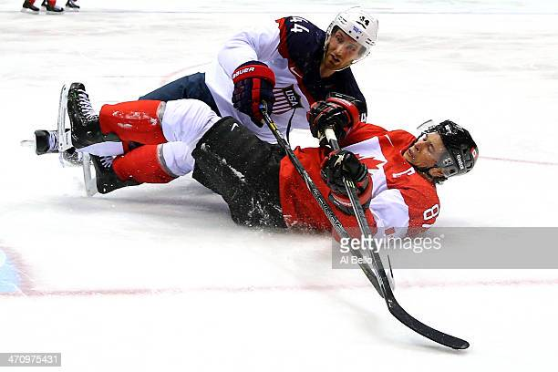Brooks Orpik of the United States and Sidney Crosby of Canada fall to the ice during the Men's Ice Hockey Semifinal Playoff on Day 14 of the 2014...