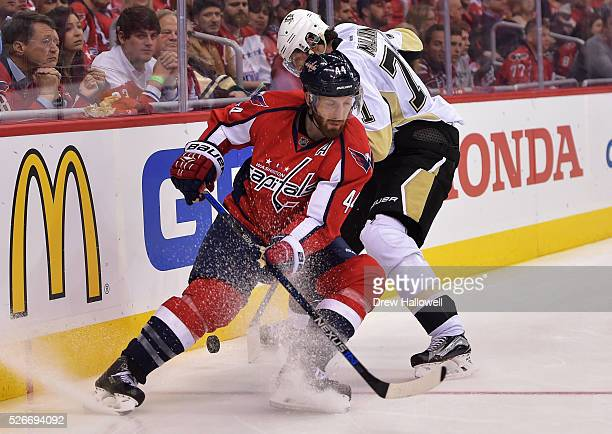 Brooks Orpik of the Washington Capitals and Evgeni Malkin of the Pittsburgh Penguins battle for the puck during Game Two of the Eastern Conference...
