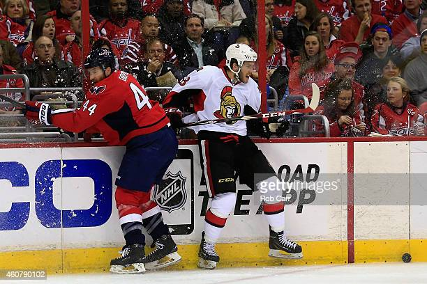 Brooks Orpik of the Washington Capitals and Mike Hoffman of the Ottawa Senators go after the puck during the third period of the Captials 21 win at...