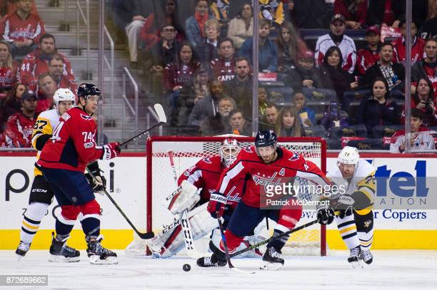 Brooks Orpik of the Washington Capitals and Patric Hornqvist of the Pittsburgh Penguins battle for the puck in the third period at Capital One Arena...