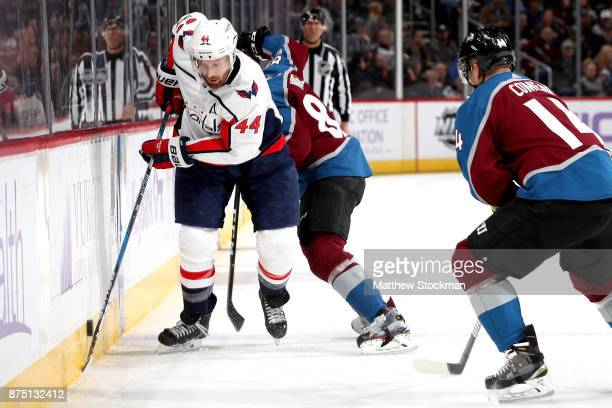 Brooks Orpik of the Washington Capitals battles on the boards against Matt Nieto of the Colorado Avalanche at Pepsi Center on November 16 2017 in...