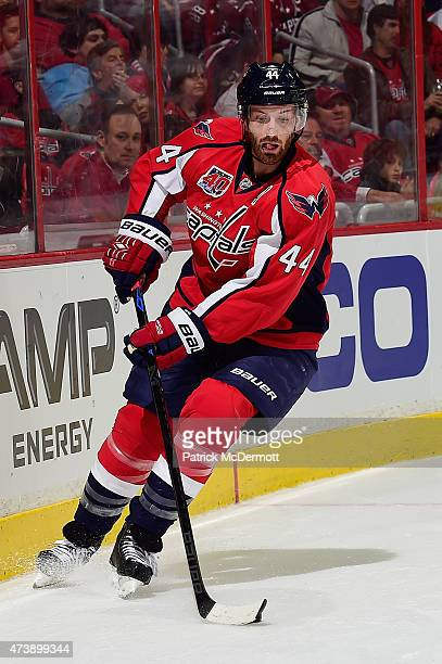 Brooks Orpik of the Washington Capitals controls the puck against the New York Islanders during the first period in Game Seven of the Eastern...