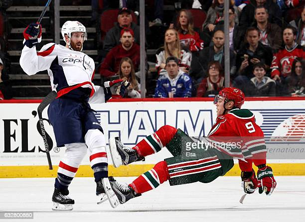 Brooks Orpik of the Washington Capitals hits Taylor Hall of the New Jersey Devils in the third period on January 26 2017 at Prudential Center in...