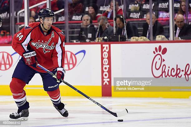 Brooks Orpik of the Washington Capitals moves the puck up ice in the first period against the Carolina Hurricanes during an NHL game at Verizon...