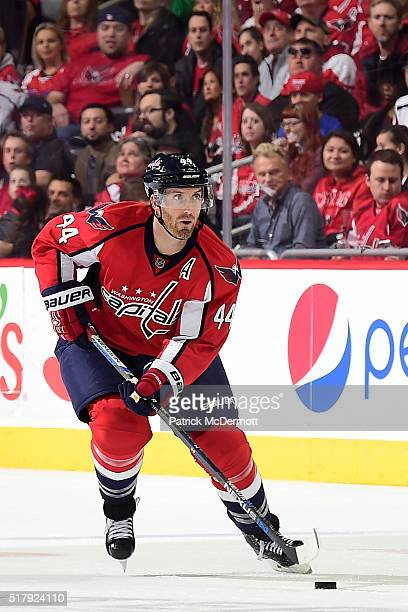 Brooks Orpik of the Washington Capitals skates with the puck in the third period during their game against the Columbus Blue Jackets at Verizon...