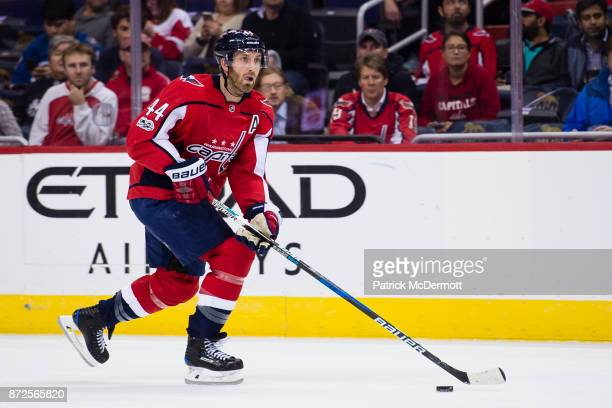 Brooks Orpik of the Washington Capitals skates with the puck in the first period against the New York Islanders at Capital One Arena on November 2...