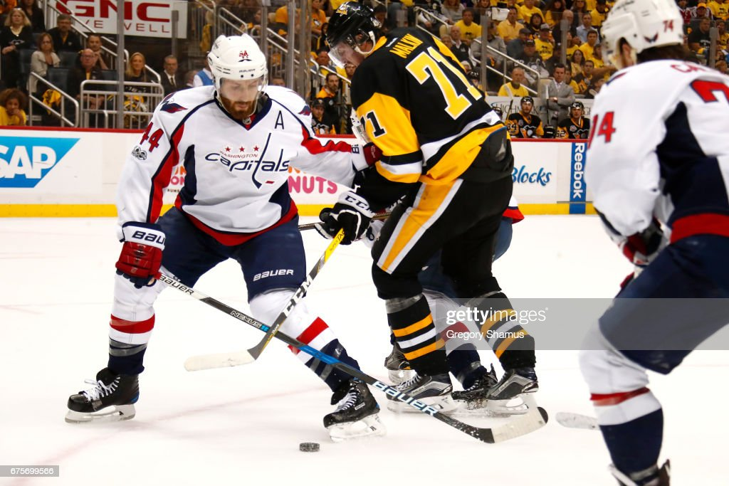 Brooks Orpik #44 of the Washington Capitals tries to take the puck from Evgeni Malkin #71 of the Pittsburgh Penguins during the second period in Game Three of the Eastern Conference Second Round during the 2017 NHL Stanley Cup Playoffs at PPG Paints Arena on May 1, 2017 in Pittsburgh, Pennsylvania.