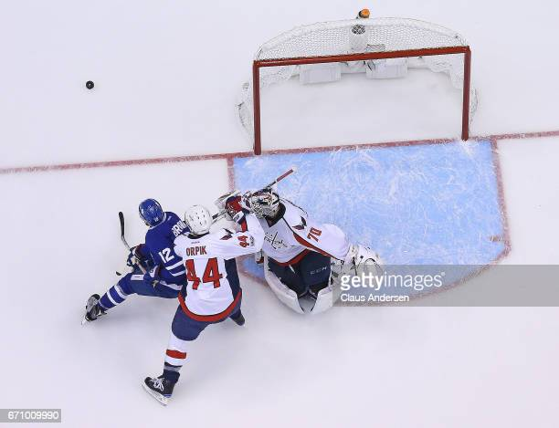 Brooks Orpik of the Washington Capitals tries to tie up Connor Brown of the Toronto Maple Leafs in Game Four of the Eastern Conference Quarterfinals...
