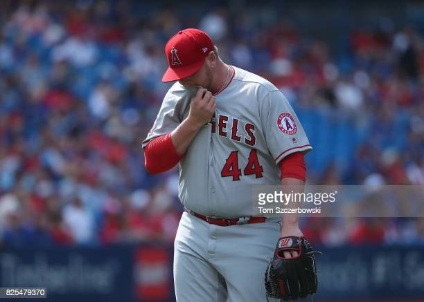 Brooks Pounders of the Los Angeles Angels of Anaheim exits the game as he is relieved in the ninth inning during MLB game action against the Toronto...