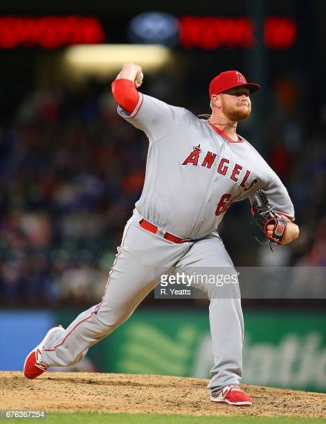 Brooks Pounders of the Los Angeles Angels of Anaheim throws in the eight inning against the Texas Rangers at Globe Life Park in Arlington on April 29...