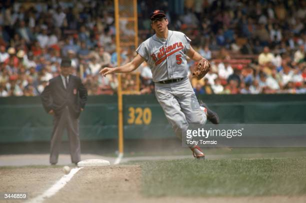 Brooks Robinson of the Baltimore Orioles fields a grounder on the third base line during a game circa 195577