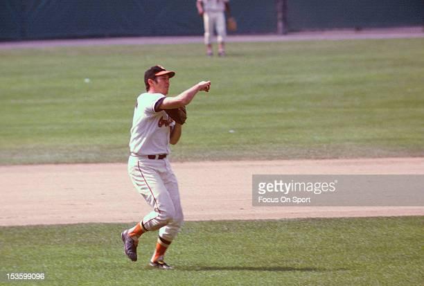 Brooks Robinson of the Baltimore Orioles makes a throw to first base during an Major League Baseball game circa 1966 at Memorial Stadium in Baltimore...