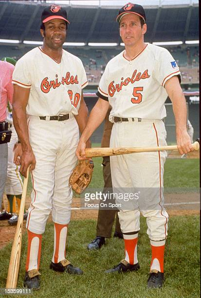 Brooks Robinson of the Baltimore Orioles poses in this portrait with teammate Frank Robinson before the start of an Major League Baseball game circa...