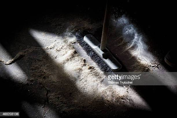 Broom whirls up dust and wood shavings on February 28 2015 in Berlin Germany