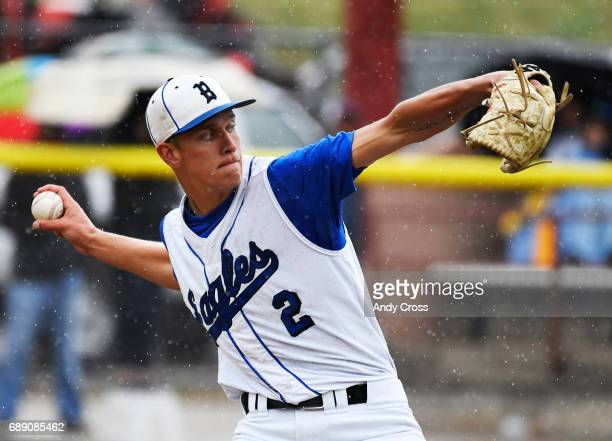 Broomfield Eagles starting pitcher Blake Rohm pitches in the rain to the Rocky Mountain Lobos in the first inning during the Colorado State 5A...