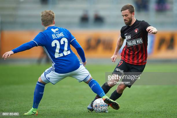 Bror Blume of Lyngby BK and Janus Drachmann of FC Midtjylland compete for the ball during the Danish Alka Superliga match between Lyngby BK and FC...