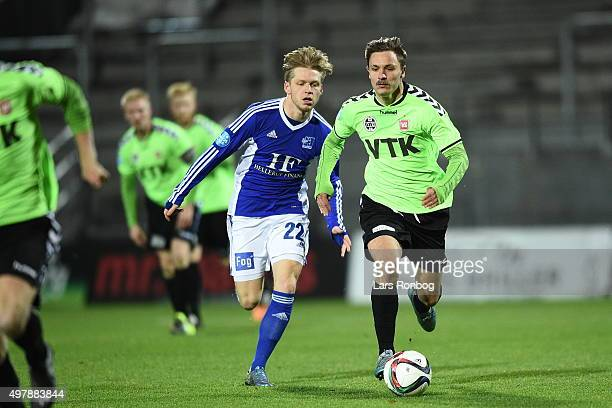 Bror Blume of Lyngby Boldklub chasing Martin Svensson of Vejle Boldklub during the Danish 1th Division Bet25 Liga match between Lyngby Boldklub and...