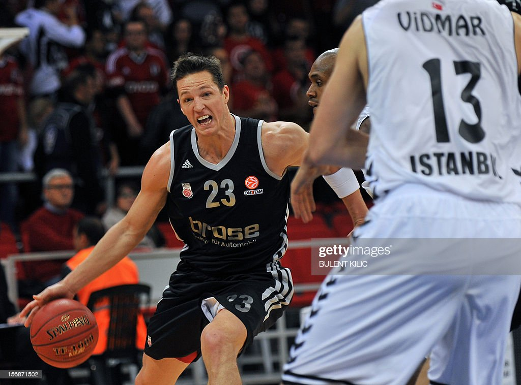 Brose Basket Bamberg's Casey Jacobsen (L) fights for the ball with Besiktas' Patrick Christopher (C) during the Euroleague basketball match between Besiktas and Brose Basket Bamberg at the Abdi Ipekci Sports Arena in Istanbul, on November 23, 2012.