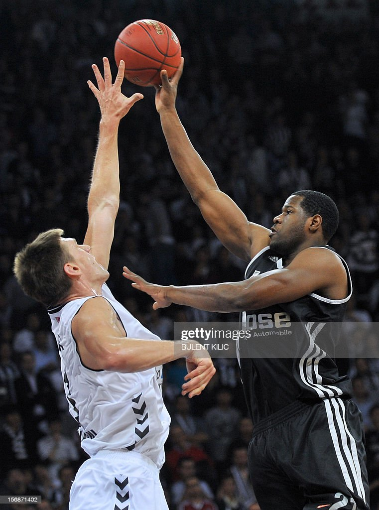 Brose Basket Bamberg's Latavious Williams (R) goes for the basket as Besiktas's Gasper Vidmar (L) blocks him during the Euroleague basketball match between Besiktas and Brose Basket Bamberg at the Abdi Ipekci Sports Arena in Istanbul, on November 23, 2012.
