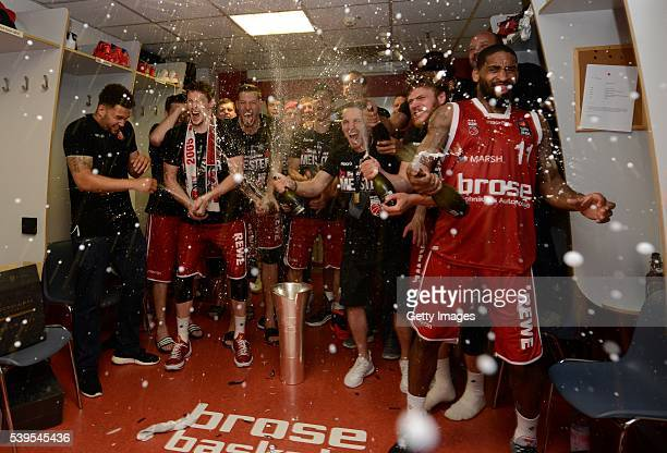 Brose Baskets Bamberg celebrate in the lockerroom with chamagne after winning the German basketball championship game three of the 2016 BBL Finals...