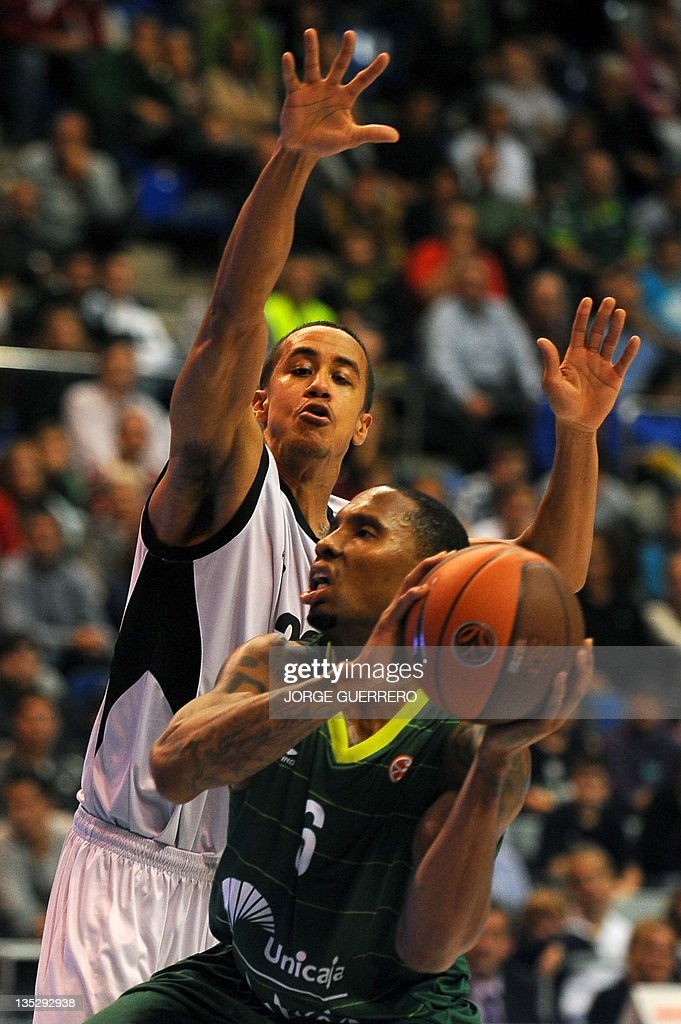 Brose Baskets' US guard Brian Roberts vies with Unicaja's US guard Earl Rowland during the Euroleague basketball match Unicaja vs Brose Baskets on...