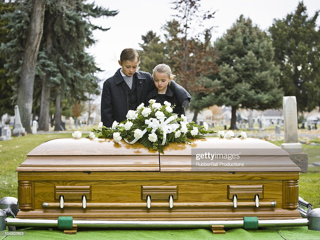 brother and sister at a funeral