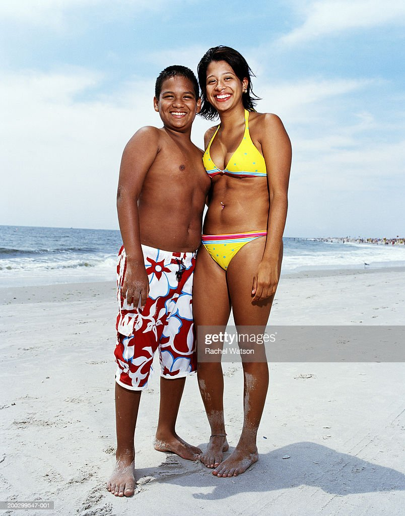 Brother and sister (11-20) at beach, portrait, summer : Stock Photo