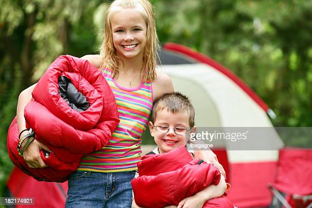 Brother and sister at camping site