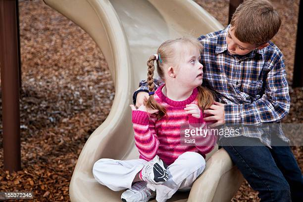 Brother and sister at playground
