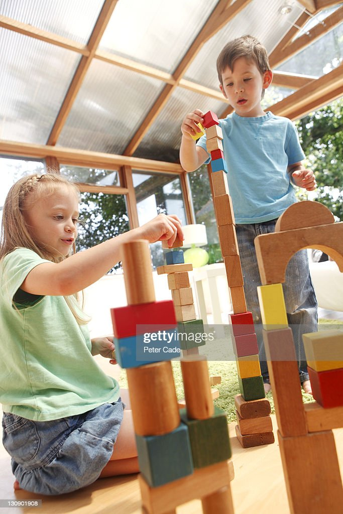 brother and sister building with toy bricks : Stock Photo