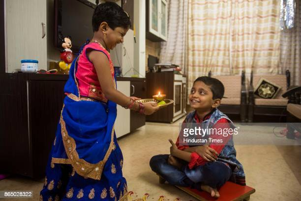 Brother and sister celebrating Bhai Dooj festival at Bhandup on October 21 2017 in Mumbai India Bhai Dooj is a most prominent and legendary festival...