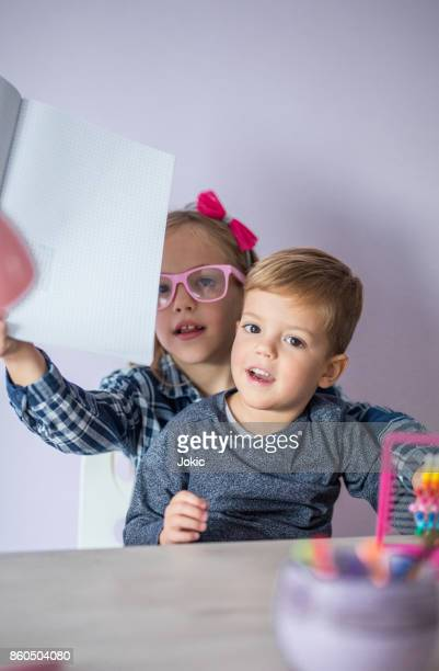 Brother and sister doing math at home