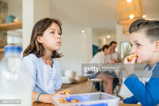 Brother and sister enjoy fresh muffins : Stock Photo