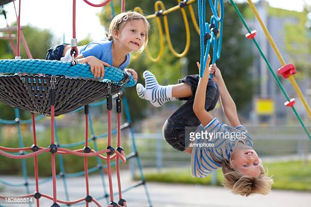 brother and sister enjoying day on playground