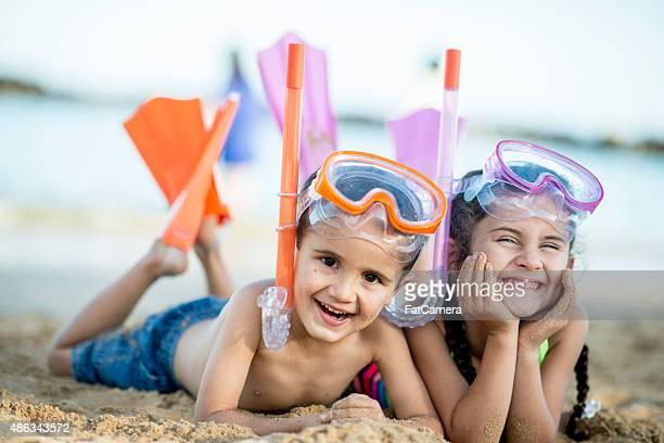 Brother and Sister Happily at the Beach