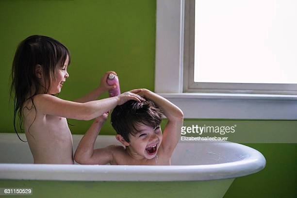 Brother and sister having a bath together