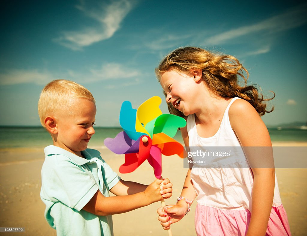 Brother and Sister having fun on the Beach. : Stock Photo